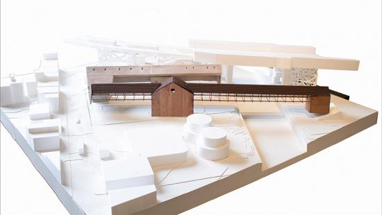 Site model of proposed wood brewery stands out in white context.