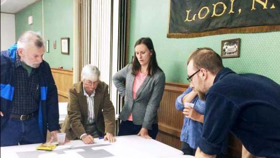 Lodi community members and Design Connect students look at plans for the library