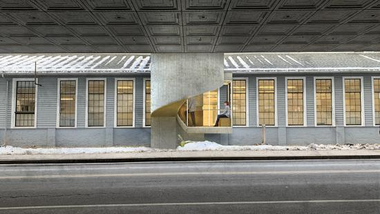 Digital rendering of the exterior of two separate buildings, connected by a modern cement and glass staircase.