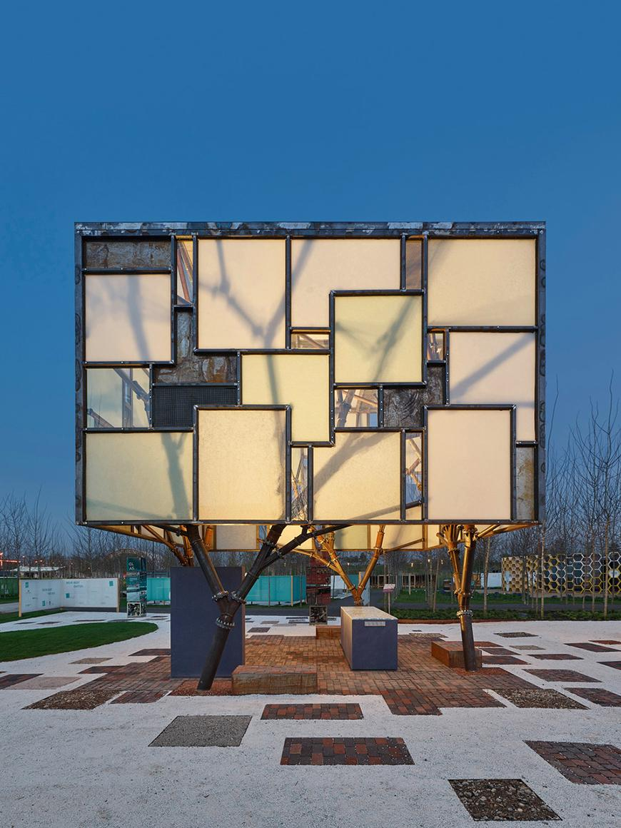 The exterior of a pavilion whose facade consists of a series of illuminated squares