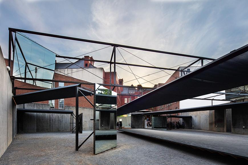 A metal outdoor canopy in an urban setting.
