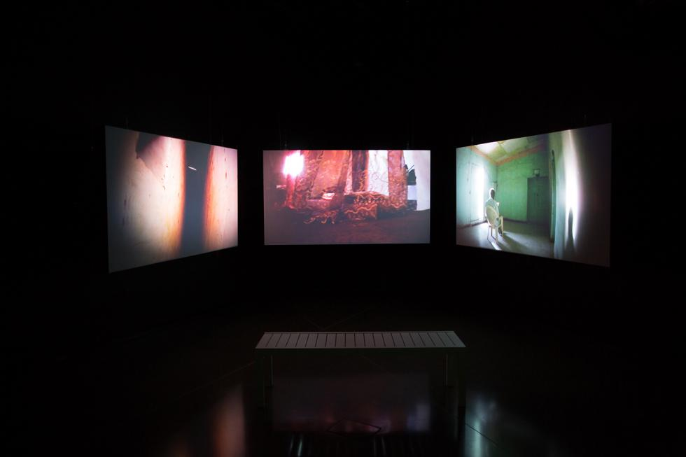 three channel color video projected in one dark room