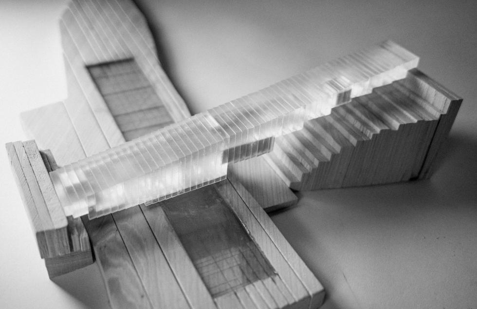 An architectural model constructed from wood and plexiglass.