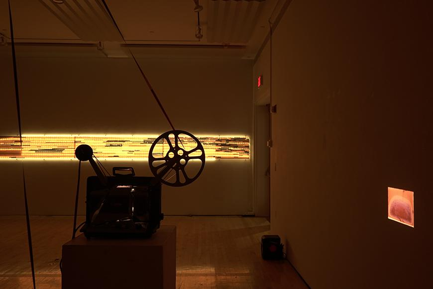 Image of projector with two projections on the walls.