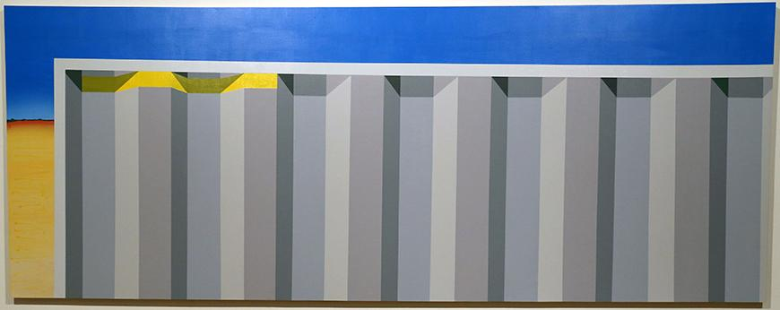 Gray framed vertical stripes in a 3-dimensional pattern against a blue and cream colored background.