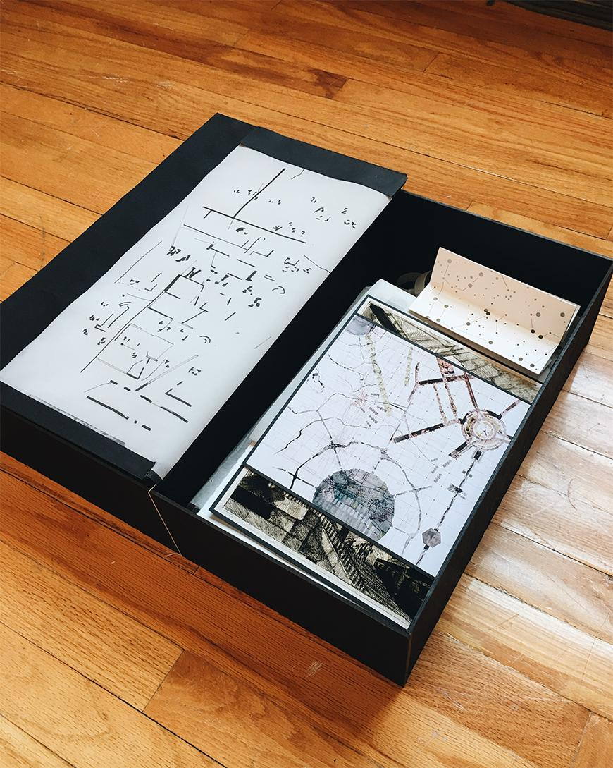 Photograph of box containing a set of different drawings and images.