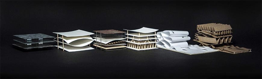 Photograph of set of six sketch models made from diverse materials, exploring layering, folding and pleating structures.