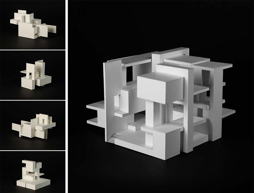 white models of square pieces of a building