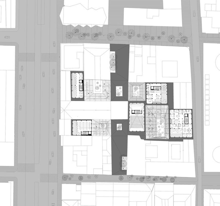Plan drawing toned with light grey to show streets and darker gray to show walls and elements cut-through.