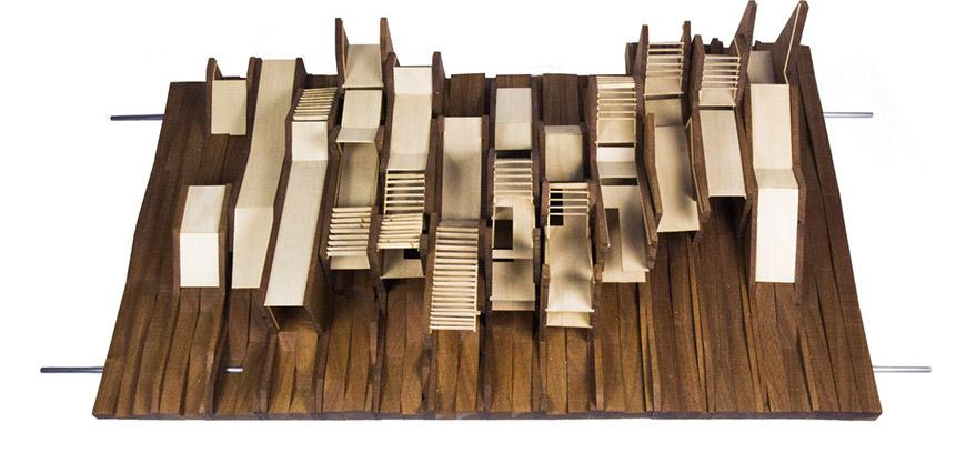 Photograph of model made of wood with basswood bridging between vertical boards of wood with varying angular profiles.