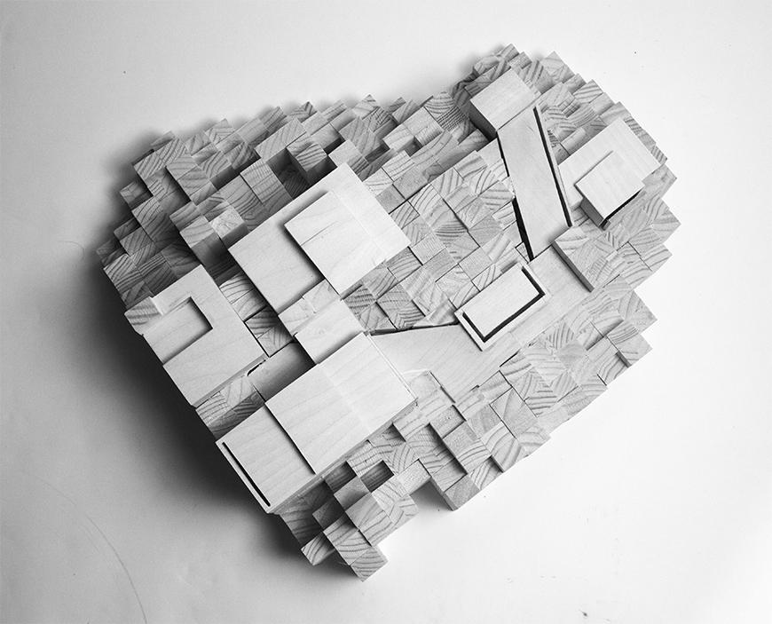 Grayscale photograph of model with site amassed from square wooden blocks or dowels, with spaces built from basswood set into the representation of the topology.