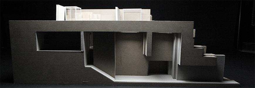 Photograph of model made from plexiglass and chipboard showing cross-section of project.