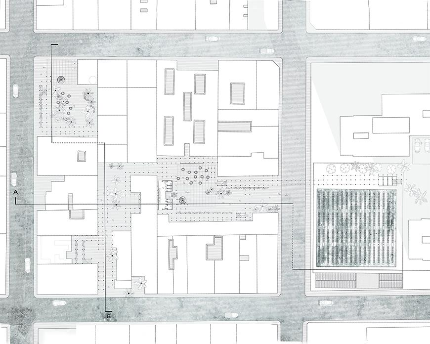 Plan drawing with streets toned darker showing a city block in which the project is proposed on the ground floor.