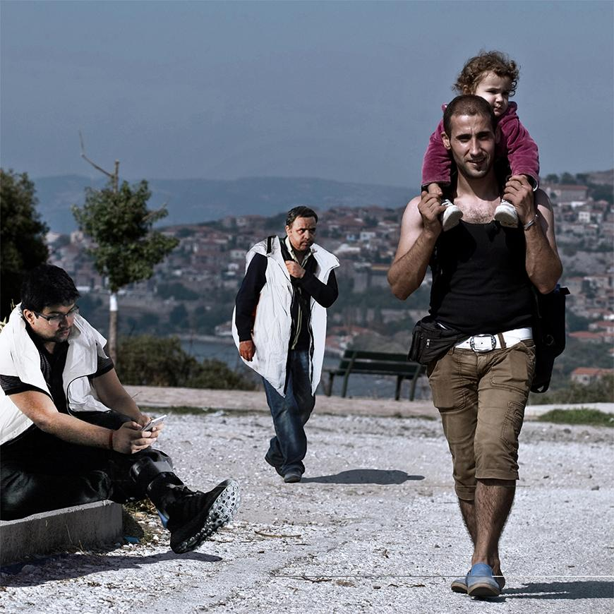 Render from photograph of refugees walking and wearing white Life Jackets.