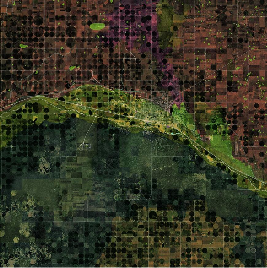 Aerial satellite map showing site with vegetation and fields in green and red tones.