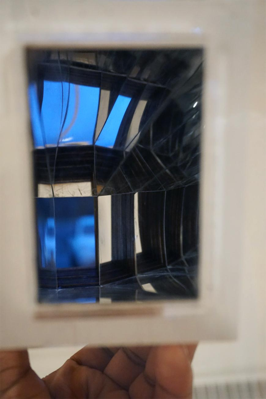 Photograph of study model held up to the camera to show effect of reflective interior walls.