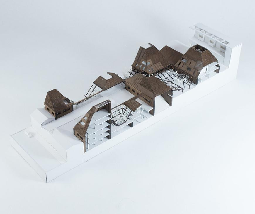 Model of the project made in white paper or chipboard material with exterior cladding in textured, laser-cut brown chipboard.