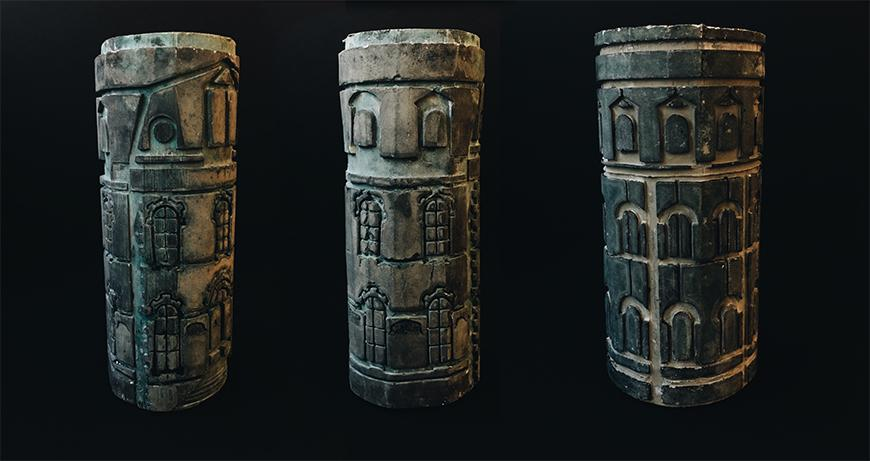 Three photographs of wooden rolls with ink stamp texture along the surface depicting a building facade.