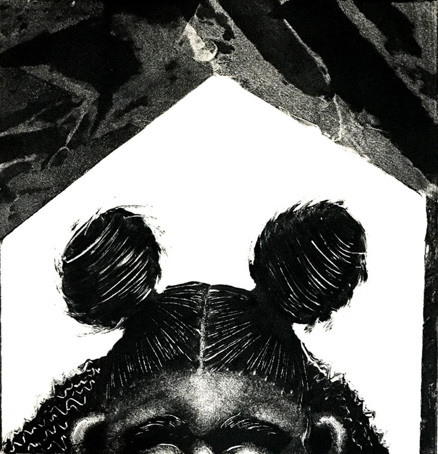 Black and white print of someone's hair in pigtail buns.