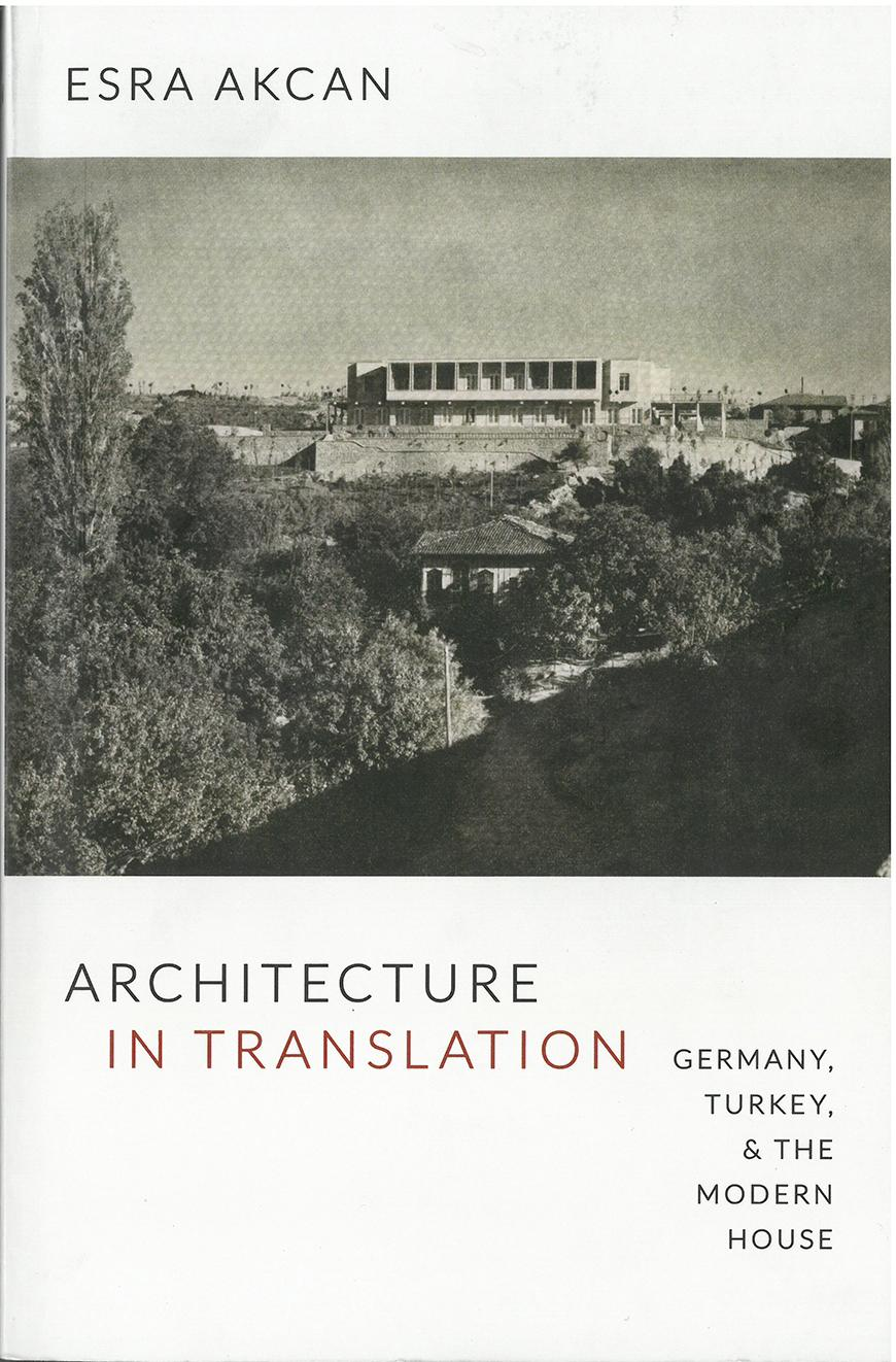 book cover with text and a black and white photo of a modern building adjacent to an older building set among trees