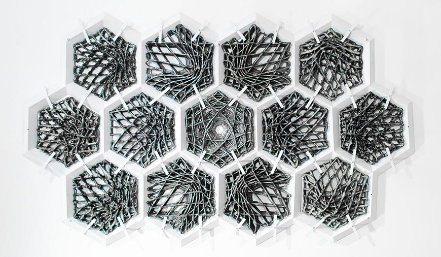 13 interlocking hexagons containing woven, tubular concrete threads