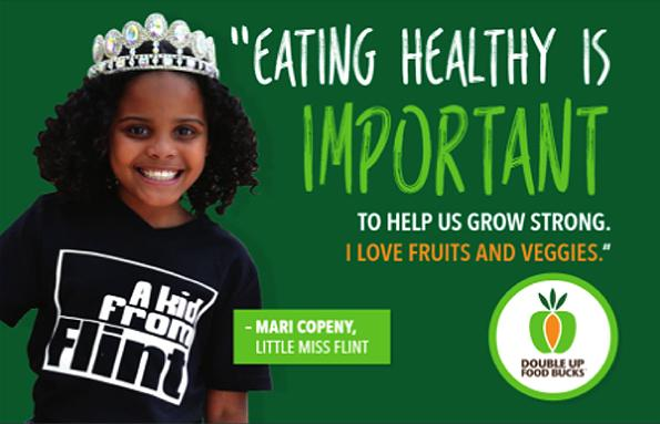 A young girl pictured with text promoting healthy eating