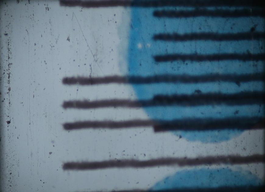 Still of horizontal black lines against a white and blue background.