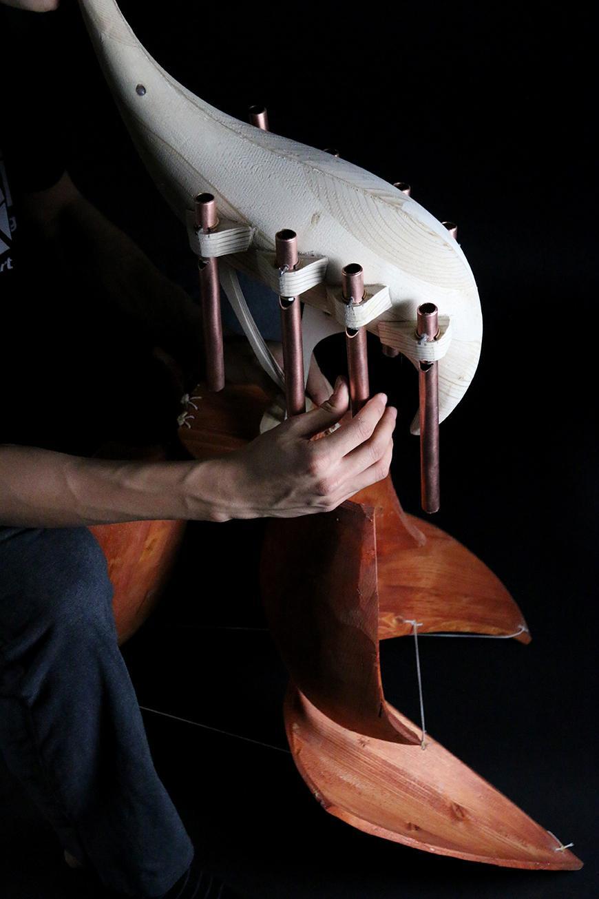 A handmade wooden instrument.