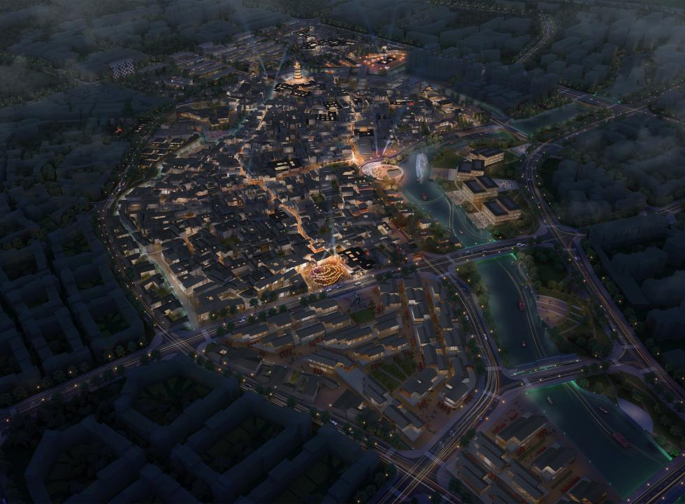 Graphic rendering of nighttime aerial over city with lighted streets