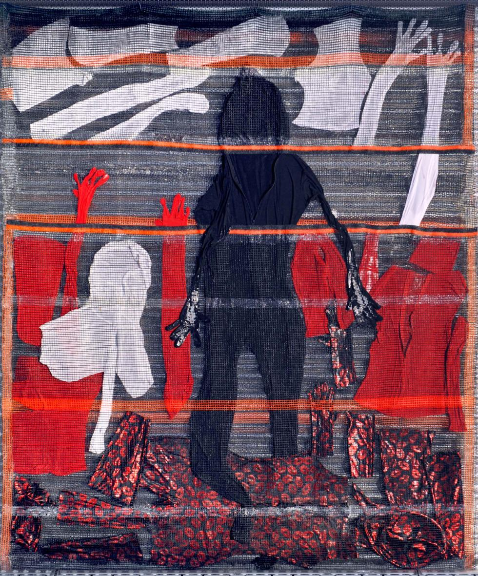 A dark abstract figure standing with different layers of dark red, white, and grey fabric.