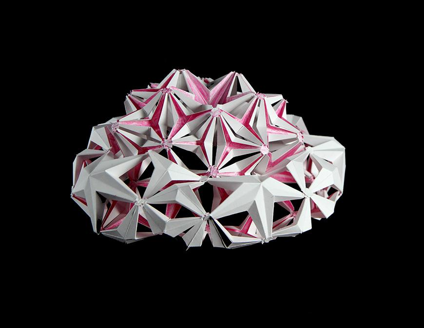 white and pink spherical honeycomb structure
