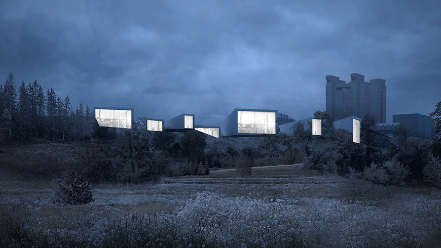 A modern series of square buildings situated in a natural landscape.