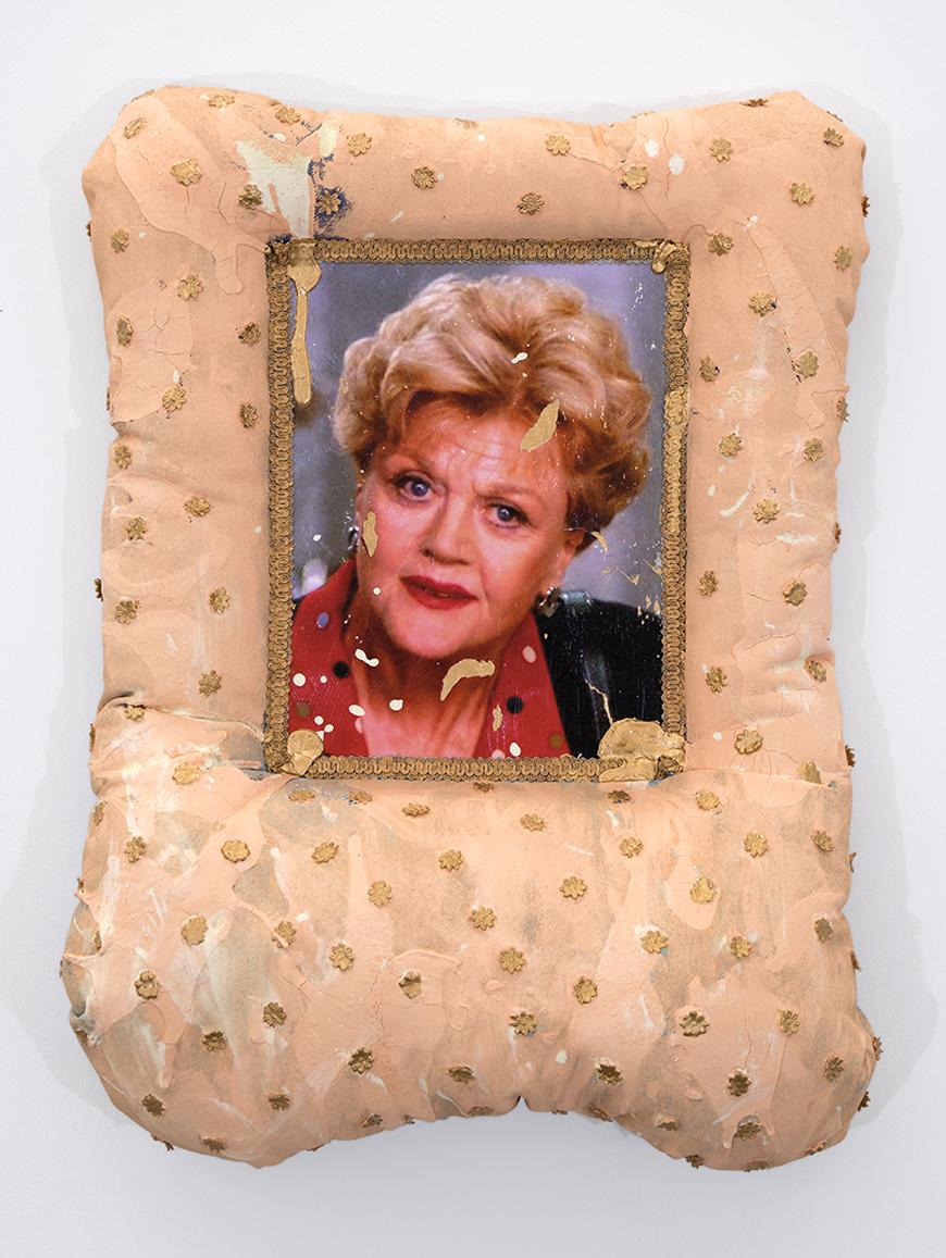 Picture of Angela Lansbury with gold colored paint spatter attached to a cream and gold polka dotted pillow.