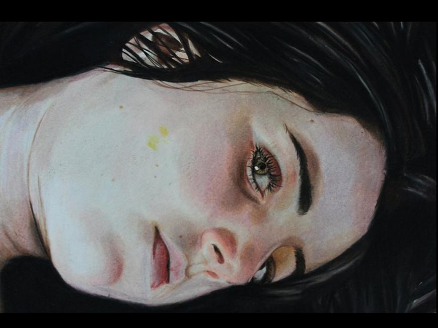 Close-up drawing of a girl's face looking down.