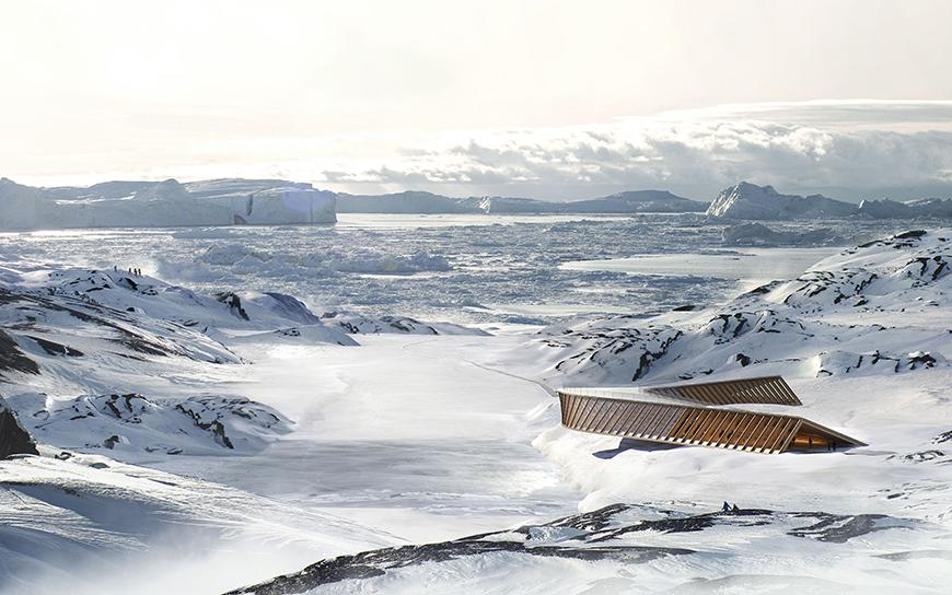 a boomerang shaped building in an icy landscape
