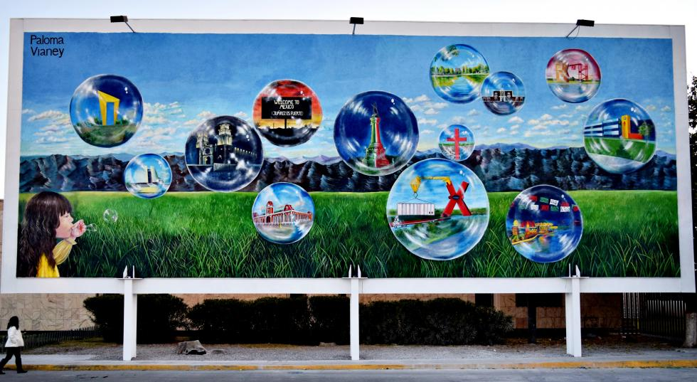 Billboard depicting a small child in the corner blowing bubbles, within each bubble is a landmark within Mexico.