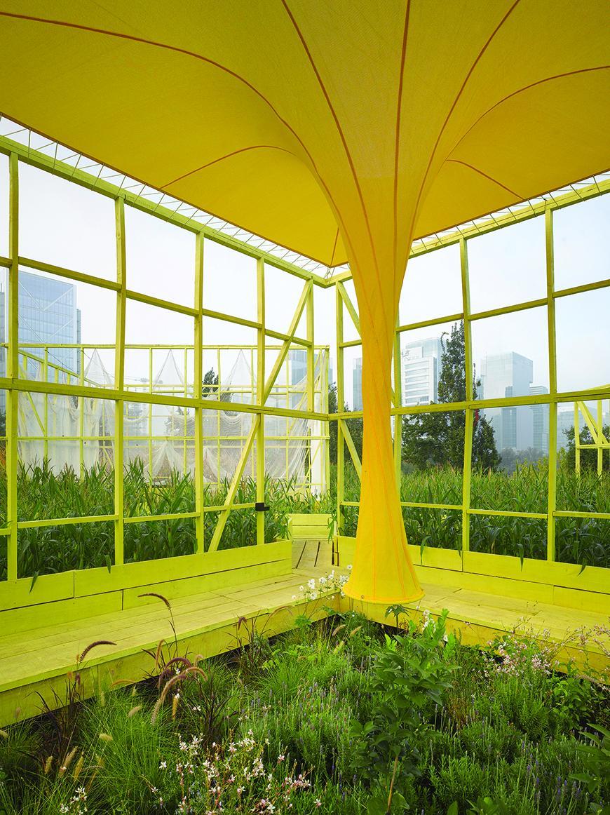 a yellow garden pavilion
