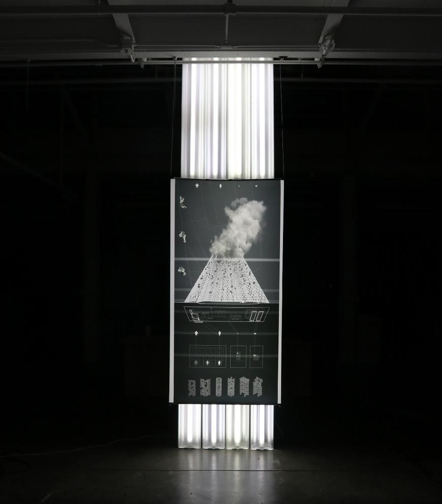Exhibition view of large printed image lit from behind.
