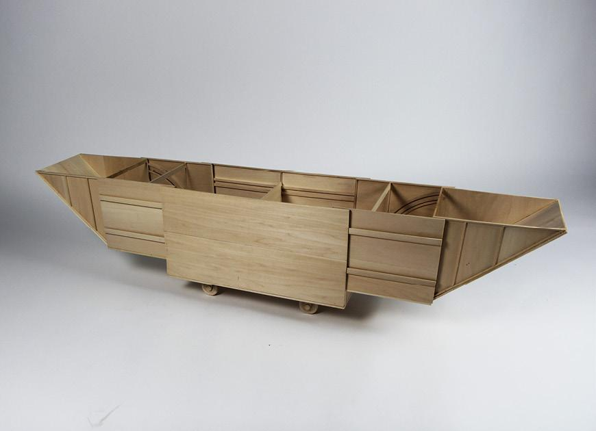 Wood boat-shaped model.