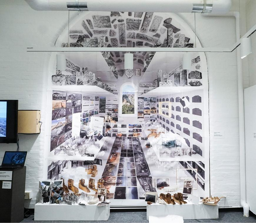 View of exhibition consisting of architectural drawings and models.