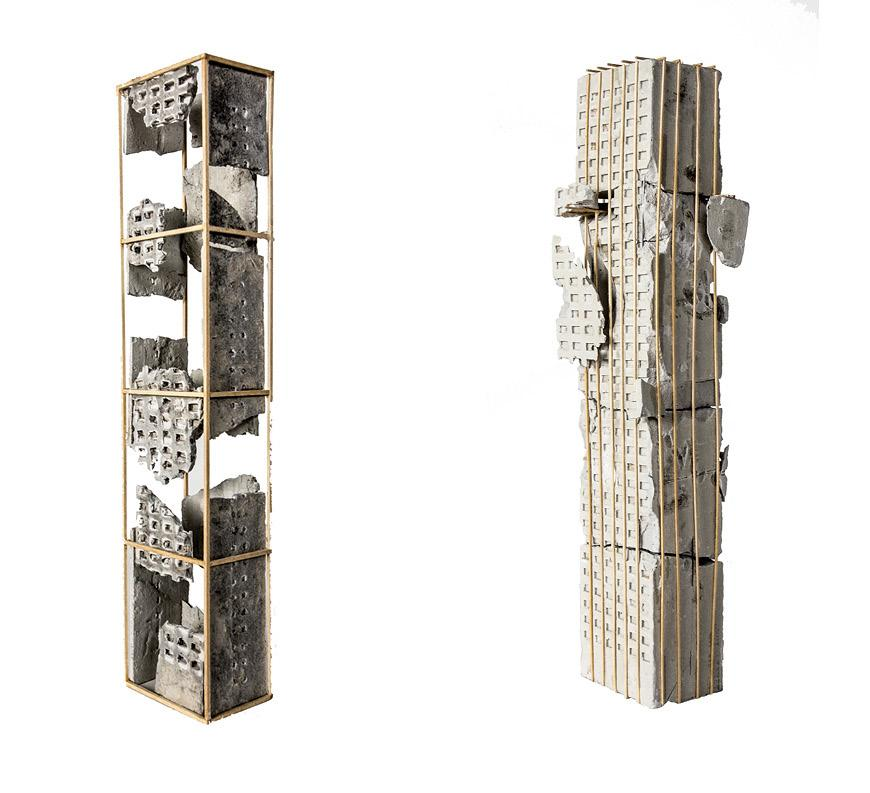 two vertical tower models made of rockite and basswood