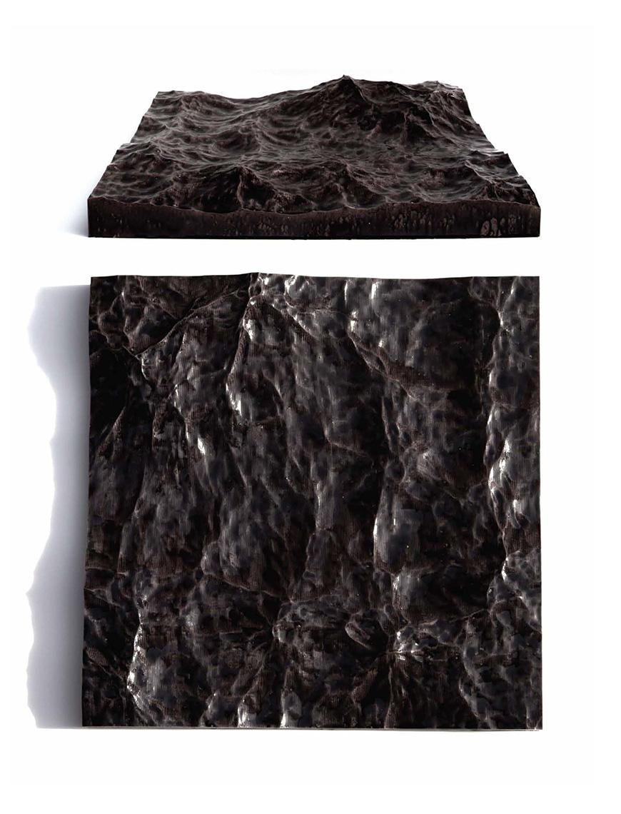 A black, square sculpture.