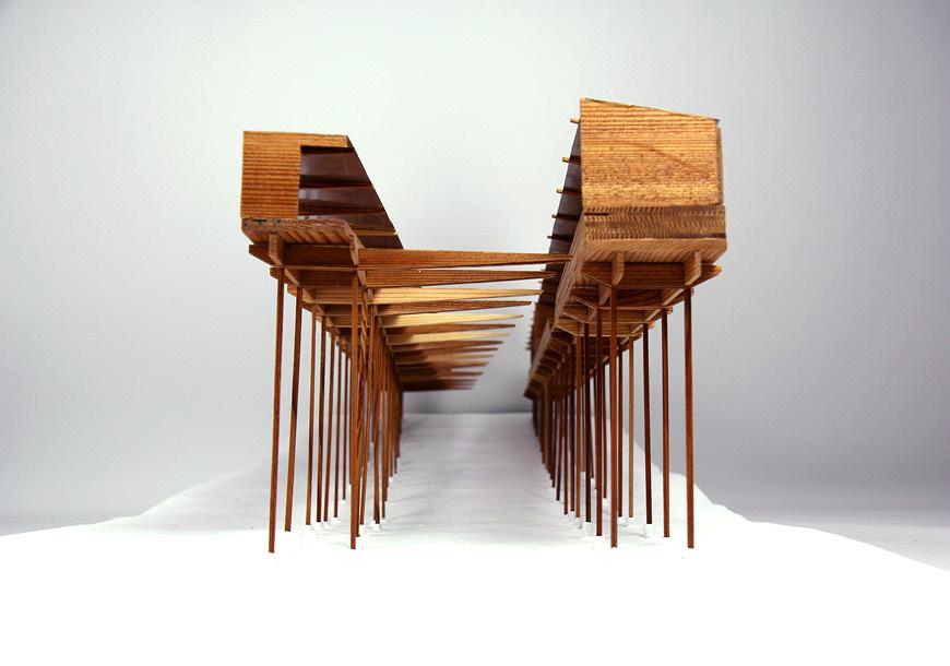 Front view of horizontal wood model on stilts.