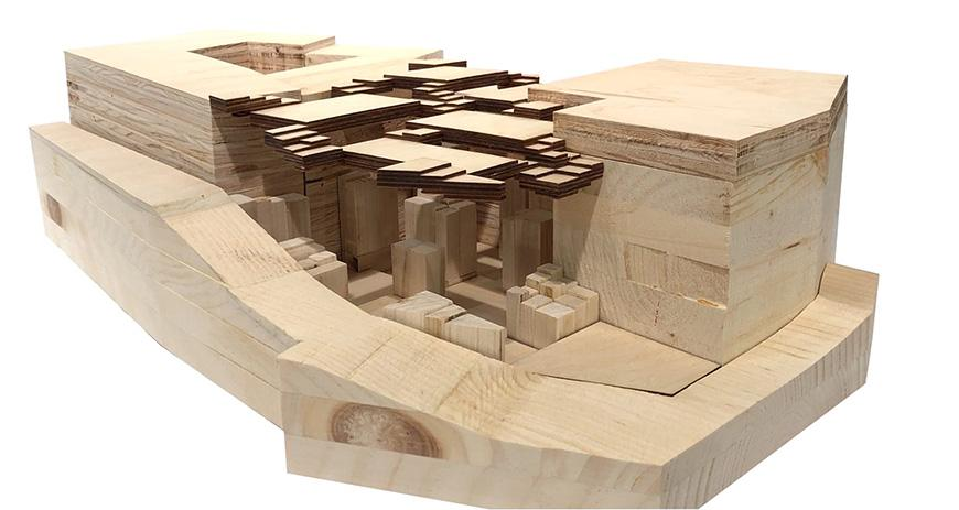 An architectural model constructed from wood.