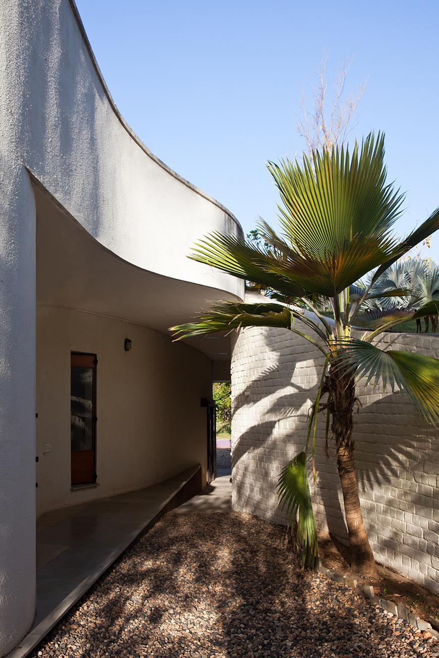 a curved stucco building facade