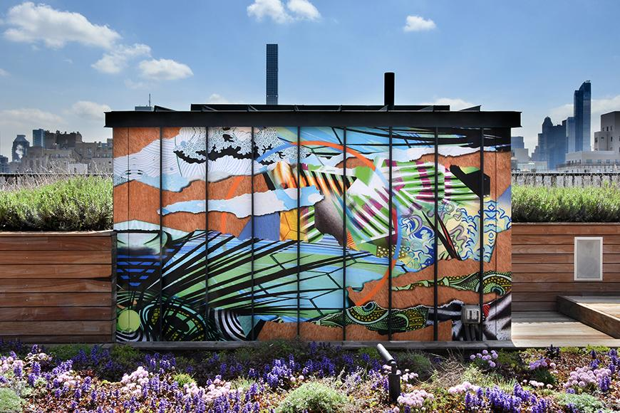 an outdoor mural painted on tall narrow panels