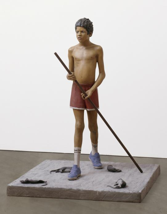 sculpture of a boy in shorts with no shirt holding a stick with four dead rats near his feet