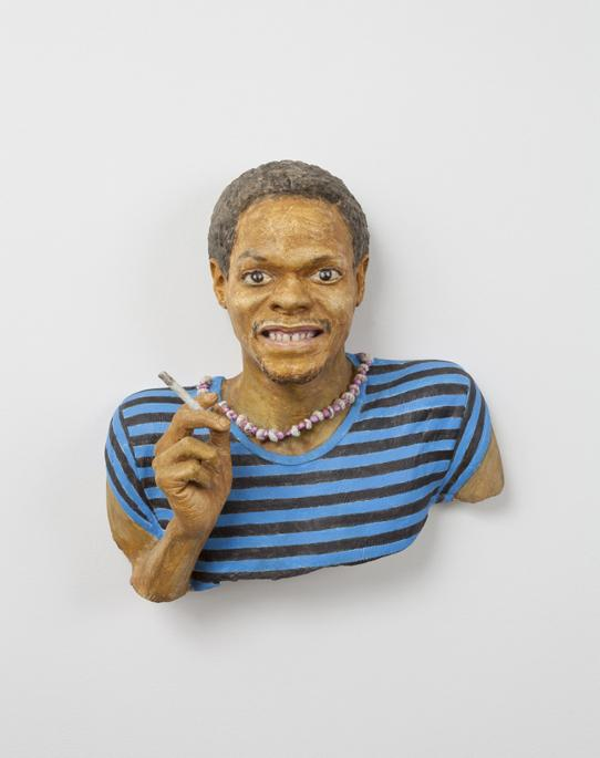 bust of a man wearing a striped blue and black shirt, with a bead necklace, and holding a cigarette