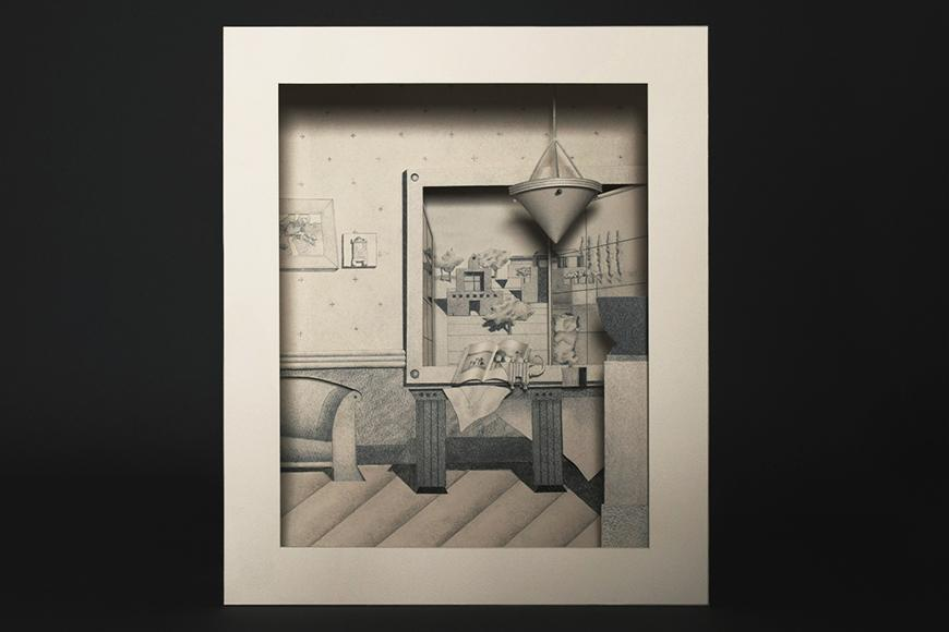 A small paper model of the interior of a home, drawn on with graphite to make the figures space more realistic.