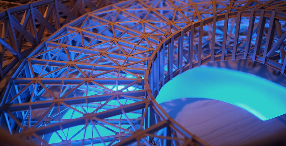 close-up of circular model with blue light showing through